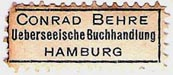 Conrad Behre, Ueberseeische Buchhandlung, Hamburg, Germany (approx 29mm x 12mm). Courtesy of Michael Kunze.