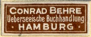 Conrad Behre, Ueberseeische Buchhandlung, Hamburg, Germany (29mm x 12mm, ca.1926). Courtesy of R. Behra.