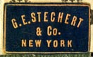 G.E. Stechert & Co., New York  (navy/khaki, 21mm x 13mm, after 1905)