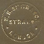 W.H. Smith & Son, London (blindstamp, 23mm dia., ca.1870s). Courtesy of Robert Behra.